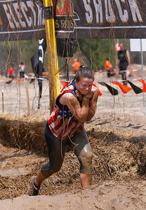 Lauren Monz, a student at Northwestern, keeps her arms in as she runs through the Electroshock Therapy obstacle during the Tough Mudder at the Richmond Hunt Club Sunday, May 11, 2014 in Richmond. The event draws 10,000 to 15,000 people to 10-12-mile obstacle courses. John Konstantaras photo for the Northwest Herald