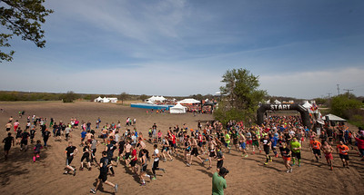 The first group of runners head out on the course for the Tough Mudder at the Richmond Hunt Club Sunday, May 11, 2014 in Richmond. The event draws 10,000 to 15,000 people to 10-12-mile obstacle courses. John Konstantaras / for the Northwest Herald