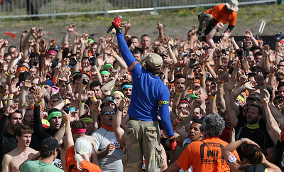 Sean Corvelle, with Hoorah 2 Heroes gets the first group fired up at the start of the Tough Mudder at the Richmond Hunt Club Sunday, May 11, 2014 in Richmond. The event draws 10,000 to 15,000 people to 10-12-mile obstacle courses. John Konstantaras / for the Northwest Herald