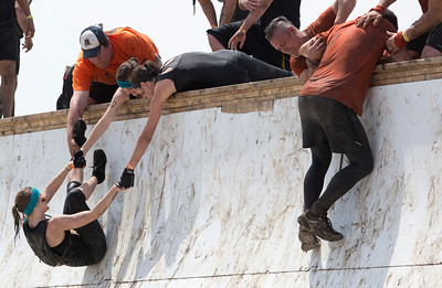 Runners help each other up the Everest obstacle during the Tough Mudder at the Richmond Hunt Club Sunday, May 11, 2014 in Richmond. The event draws 10,000 to 15,000 people to 10-12-mile obstacle courses. John Konstantaras / for the Northwest Herald