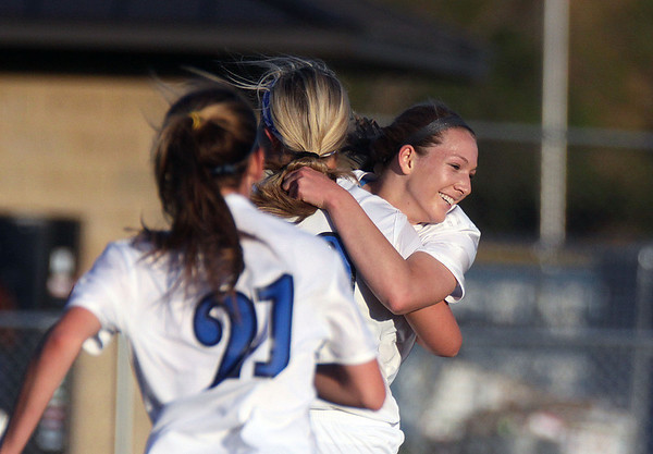 Jeff Krage – For Shaw Media<br /> Geneva's Michaela Loebel, right, is congratulated after scoring a goal in the first half of Friday's game against visiting St. Charles East.<br /> Geneva 5/9/14