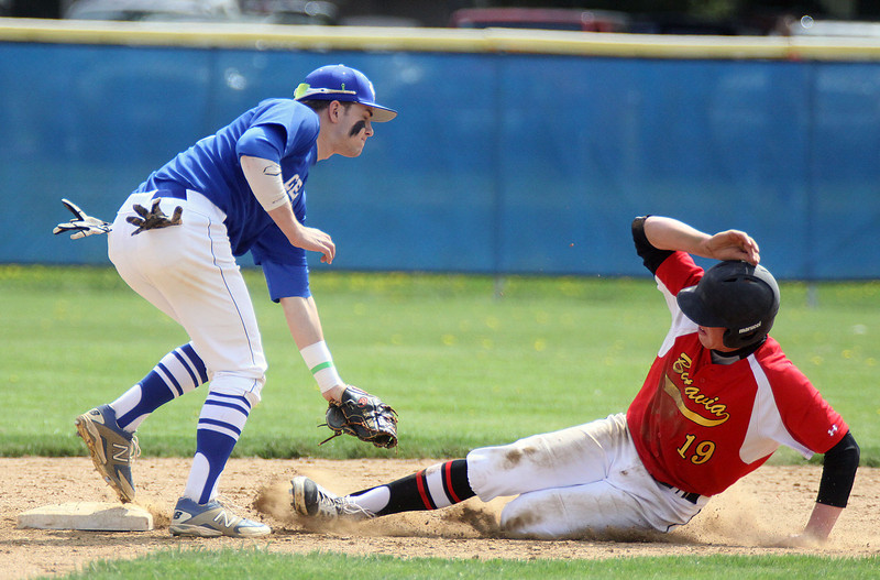 Jeff Krage – For Shaw Media<br /> Geneva shortstop Nick Derr tags out Batavia's Kyle Niemiec at second base on a steal attempt in the second inning of game one during Saturday's doubleheader in Geneva. <br /> Geneva 5/10/14