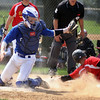 Jeff Krage – For Shaw Media<br /> Geneva catcher Nathan Montgomery is unable to tag out Batavia's Micah Coffey in the third inning of game one during Saturday's doubleheader at Geneva. <br /> Geneva 5/10/14