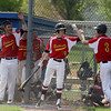 Jeff Krage – For Shaw Media<br /> Batavia's Willie Firth (#3) is congratulated by Reagan McReynolds (#24) after scoring in the third inning of game one during Saturday's doubleheader at Geneva. The run gave the Bulldogs a 5-0 lead. <br /> Geneva 5/10/14