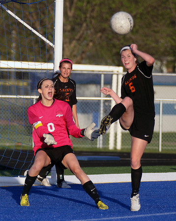 Jeff Krage – For Shaw Media<br /> St. Charles East goal keeper Kendra Sheehan reacts as Kelli Santo Paolo kicks the ball out of the box during Friday's game at Geneva.<br /> Geneva 5/9/14
