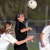 Jeff Krage – For Shaw Media<br /> St. Charles East's Ally Potterton heads the ball during Friday's game at Geneva.<br /> Geneva 5/9/14