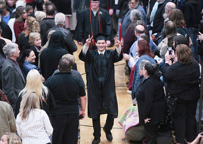 Michelle LaVigne/ For Shaw Media Graduating high school senior Matthew Jordan Haun makes his entrance into the gymnasium for the McHenry East High School's commencement in McHenry on May 15, April 15, 2014.