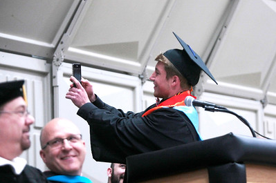 """Michelle LaVigne/ For Shaw Media McHenry East High School class president Thomas Hellios takes a """"selfie"""" before addressing the graduating class of 2014 during McHenry East High School's commencement in McHenry on May 15, April 15, 2014."""