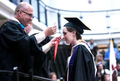 Michelle LaVigne/ For Shaw Media Sara Wimmer is given her honors medal by principal Eric Blake during McHenry East High School's commencement in McHenry on May 15, April 15, 2014.