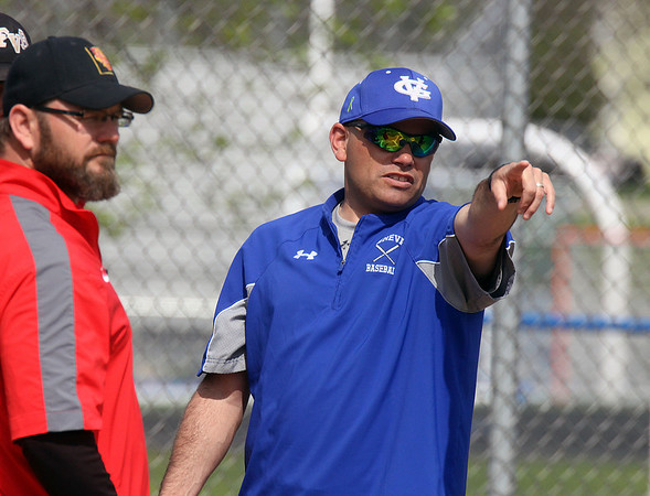 Jeff Krage – For Shaw Media<br /> Geneva varsity baseball head coach Matt Hahn, right, goes over rules with Batavia head coach Matt Holm before the start of Saturday's doubleheader in Geneva.<br /> Geneva 5/10/14