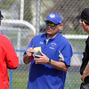 Jeff Krage – For Shaw Media<br /> Geneva varsity baseball head coach Matt Hahn talks with Batavia head coach Matt Holm and umpires before the start of Saturday's doubleheader in Geneva.<br /> Geneva 5/10/14