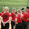 Jeff Krage – For Shaw Media<br /> Aurora Christian softball head coach Rich Hazlett talks with his players after Monday's loss at Wheaton Academy.<br /> West Chicago 5/12/14