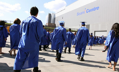Jeff Krage - For Shaw Media Dundee-Crown High School seniors make their toward the Sears Centre before the start of Saturday's graduation ceremonies in Hoffman Estates.