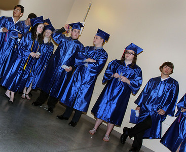 Jeff Krage - For Shaw Media Dundee-Crown High School graduates wait under the concourse for the start of Saturday's graduation ceremonies at the Sears Centre in Hoffman Estates.