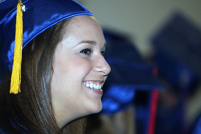 Jeff Krage - For Shaw Media Dundee-Crown High School graduate Alexandria Hawkey smiles during Saturday's graduation ceremonies at the Sears Centre in Hoffman Estates.