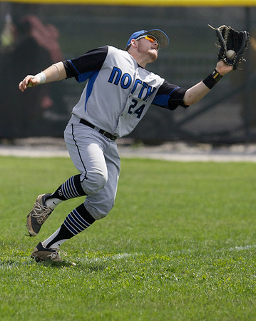 Karen Naess For The Kane County Chronicle<br />  St. Charles North's Jack Dennis makes a running catch against Batavia on Saturday in Batavia.