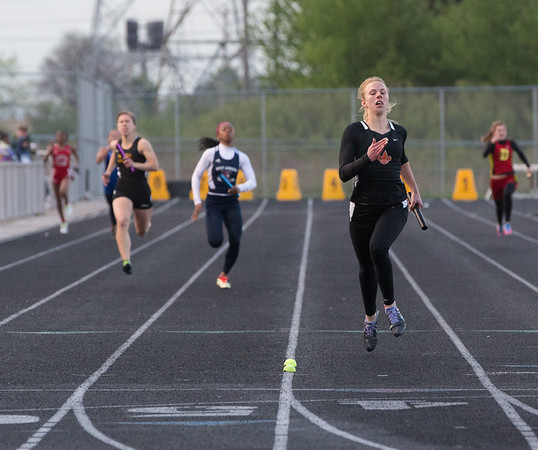 St. Charles East's Allison Chmelik runs anchor during the 4 x 200 meter relay race at the Metea Valley Girls Track and Field Sectional at Metea Valley High School in Aurora, IL on Thursday, May 15, 2014 (Sean King for Shaw Media)