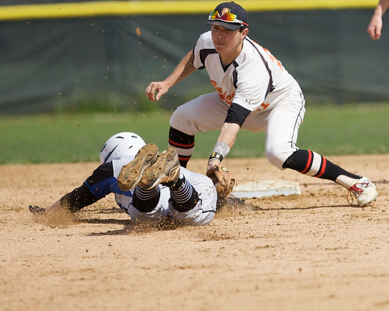 Karen Naess For The Kane County Chronicle<br /> Batavia's Jeremy Schoessling applies the tag on St. Charles Norht's Nick Drawant at secondbase on Saturday in Batavia.