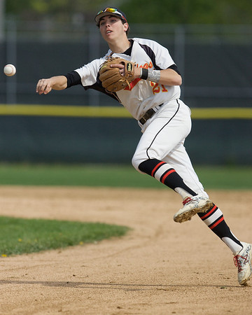 Karen Naess For The Kane County Chronicle<br /> Batavia's Jeremy Schoessling fires to first for an out against St. Charles North on Saturday in Batavia.