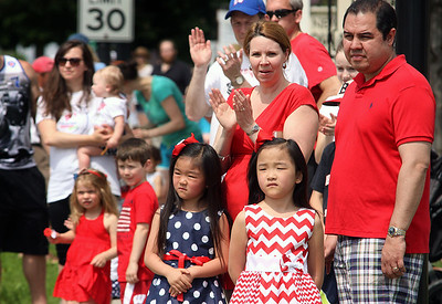 Jeff Krage – For Shaw Media Crowds line Main Street in downtown Barrington and cheer as the Barrington High School Marching Band nears during Monday's Memorial Day parade.  Barrington 5/26/14
