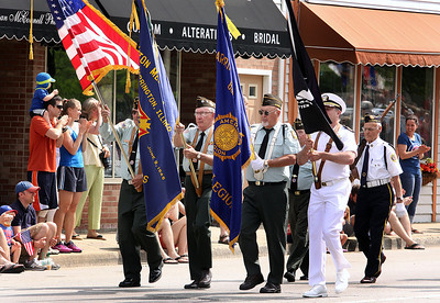 Jeff Krage – For Shaw Media Members of the VFW 7706 lead Monday's Memorial Day parade through downtown Barrington. Barrington 5/26/14