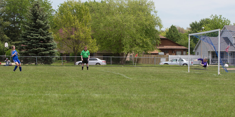 Rosary's Maria Witte (13) watches as her game winning penalty kick sails past Kaneland's goal keeper Emily Chapman (23) during the Rosary Girls 2A Regional Final<br /> at Rosary High School in Aurora, IL on Saturday, May 24, 2014 (Sean King for Shaw Media)