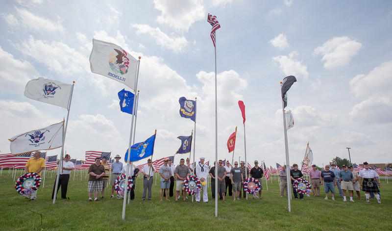 Veterans from five branches of the armed forces Help Lay Wreaths in Wreath Laying Ceremony during the Healing Field Memorial Day Ceremony at Kaneland High School in Maple Park, IL on Monday,May 26, 2014 (Sean King for Shaw Media)