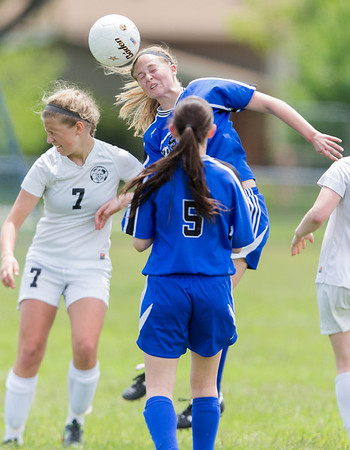 Rosary's Maria Witte (13) goes up for a header against Kaneland's Heather Ortiz (7)during the Rosary Girls 2A Regional Final at Rosary High School in Aurora, IL on Saturday, May 24, 2014 (Sean King for Shaw Media)