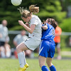 Kaneland's Brittany Olson (15) goes up for a header against Rosary's Cassie Duck (5)during the Rosary Girls 2A Regional Final at Rosary High School in Aurora, IL on Saturday, May 24, 2014 (Sean King for Shaw Media)