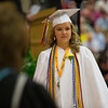 Geneva High School graduate and Class of 2014 President Hallie McQueeny walks to the podium for the presentation of class members during the school's<br /> commencement ceremony at Geneva High School in Geneva, IL on Sunday, May 25, 2014 (Sean King for Shaw Media)