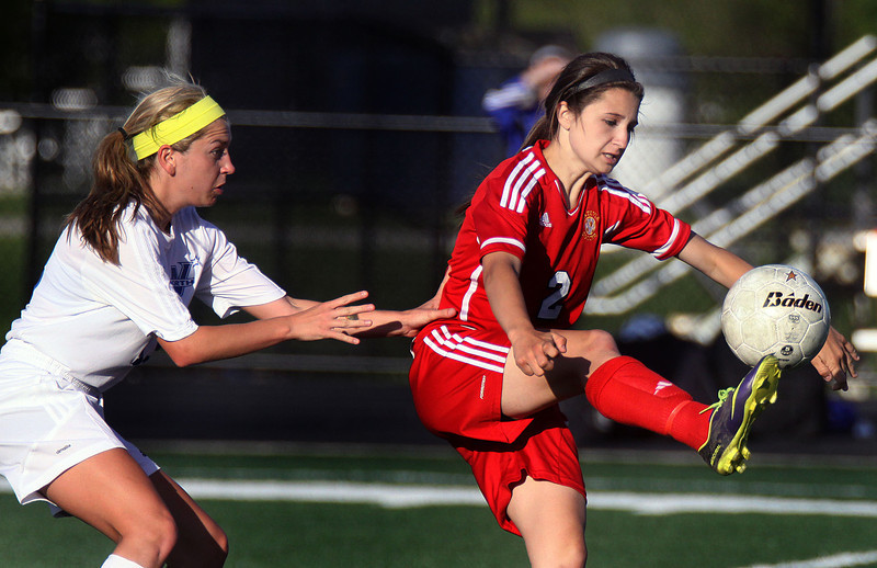 Jeff Krage – For Shaw Media<br /> Batavia's Megan McEachern controls the ball while defended by St. Charles North's Darcy Stoecklin during Friday's IHSA Class 3A regional championship at Addison Trail High School.<br /> Addison 5/23/14
