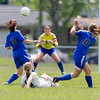 Kaneland's Brittany Olson (15) shoots the ball between Rosary's Anna Sheen (18) and Sonja Popovich (10)<br /> during the Rosary Girls 2A Regional Final at Rosary High School in Aurora, IL on Saturday, May 24, 2014 (Sean King for Shaw Media)