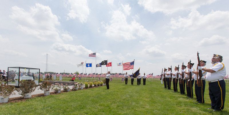 Members of the Maple Park American Legion perform TAPS during the conclusion of the Healing Field Memorial Day Ceremony at Kaneland High School in Maple Park, IL on Monday,May 26, 2014 (Sean King for Shaw Media)