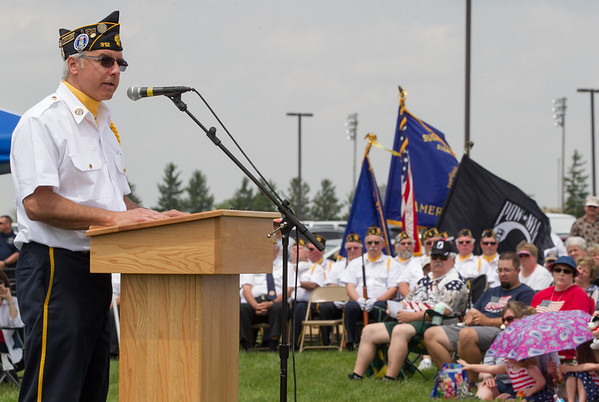 Commander Donald Grillo of Maple Park American Legion Post 312 speaks to the crowd during the Healing Field Memorial Day Ceremony at Kaneland High School in Maple Park, IL on Monday,May 26, 2014 (Sean King for Shaw Media)