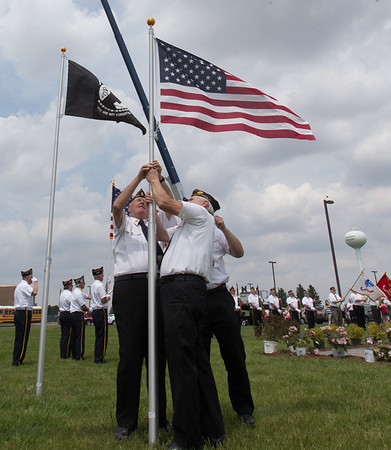 Members of the Sugar Grove American Legion Post 1271 perform the Noon Raising of the American Flag to Full Staff<br /> during the Healing Field Memorial Day Ceremony at Kaneland High School in Maple Park, IL on Monday,May 26, 2014 (Sean King for Shaw Media)