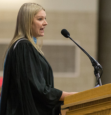 Geneva High School English Teacher Mrs. Heather Peters speaks to graduates and encourages them not fear the future during the school's commencement ceremony at Geneva High School in Geneva, IL on Sunday, May 25, 2014 (Sean King for Shaw Media)