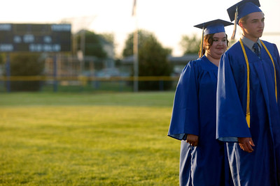 Michelle LaVigne/ For Shaw Media The final two graduates, Erich Zawacki and Alyssa Zigante, wait to receive their diplomas during the Johnsburg High School graduation ceremony in Johnsburg on May 30, 2104.