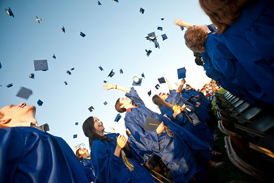 Michelle LaVigne/ For Shaw Media Morgan Diedrich and Dyaln Dingman (middle) join their classmates in celebrating their graduation after the  the Johnsburg High School graduation ceremony in Johnsburg on May 30, 2104.