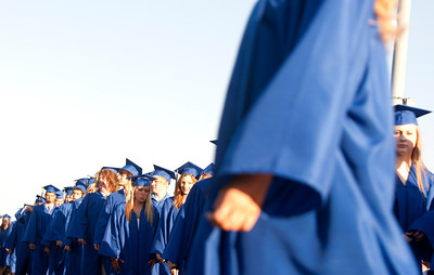 Michelle LaVigne/ For Shaw Media The Johnsburg graduates walk on to the football field for the beginning of the Johnsburg High School graduation ceremony in Johnsburg on May 30, 2104