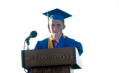 "Michelle LaVigne/ For Shaw Media Sean Nykaza delivers the introduction of Salutatorian. Nykaza ended his speech with a nod to the ""Hunger Games"" movie stating, ""May the odds be ever in your favor"" during the Johnsburg High School graduation ceremony in Johnsburg on May 30, 2104"