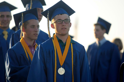 Michelle LaVigne/ For Shaw Media Valedictorian Ian (behind,) and Salutorian Sean Nykaza wait to receive their diplomas during the Johnsburg High School graduation ceremony in Johnsburg on May 30, 2104. This was the first time in Johnsburg School history that twins were both the Valedictorian and Solitarian.