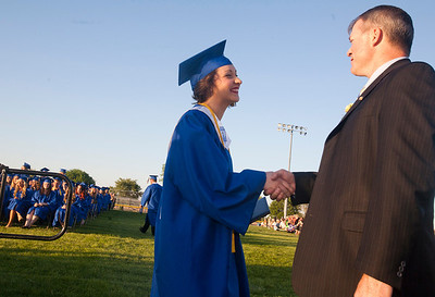 "Michelle LaVigne/ For Shaw Media Johnsburg High School principal asks graduating senior Amanda Frazier ""Who's going to give me flack int he hallway now?"" after she finished receiving her diploma during the Johnsburg High School graduation ceremony in Johnsburg on May 30, 2104."