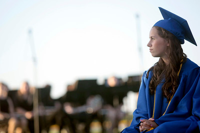 Michelle LaVigne/ For Shaw Media Kelly Ackerman listens to speeches prior to receiving her diploma during the Johnsburg High School graduation ceremony in Johnsburg on May 30, 2104.