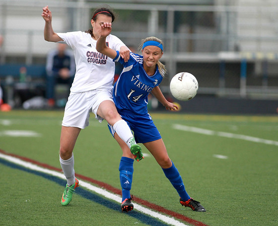 Geneva's Courtney Lardas (14) battles Conant's Stephanie Buga for the ball during their Conant Sectional semifinal game in Hoffman Estates Wednesday.