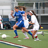 Geneva's Mary Landry (21) chases the ball during their Conant Sectional semifinal game against Conant in Hoffman Estates Wednesday.