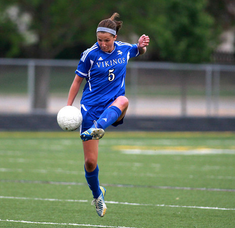 Geneva's Tory Herbst kicks the ball during their Conant Sectional semifinal game against Conant in Hoffman Estates Wednesday.