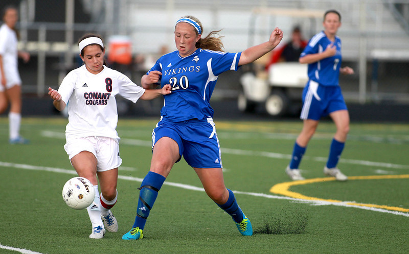 Geneva's Taylor Williams (20) battles Conant's Bianca Madonia (8) for the ball during their Conant Sectional semifinal game in Hoffman Estates Wednesday.