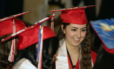 Jeff Krage – For Shaw Media Huntley graduate Brenna Lacey shares a smile with classmates before the start of Saturday's graduation ceremonies at the Sears Centre in Hoffman Estates. Hoffman Estates 5/31/14