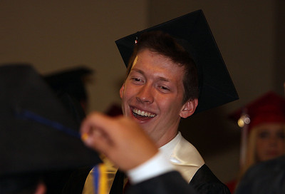 Jeff Krage – For Shaw Media Huntley graduate Austin Madeya laughs as a classmate adjusts his cap before the start of Saturday's graduation ceremonies at the Sears Centre in Hoffman Estates. Hoffman Estates 5/31/14