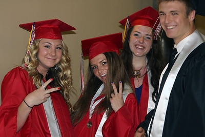 Jeff Krage – For Shaw Media Huntley graduate's (left to right) Erin Lyman, Emily Westermeyer, Brittney Gundlach and Daniel Janus pose for a picture before the start of Saturday's graduation ceremonies at the Sears Centre in Hoffman Estates. Hoffman Estates 5/31/14
